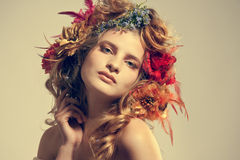 Beautiful woman with flowers in her hair Royalty Free Stock Images