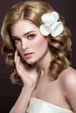A beautiful woman with flowers on her head stock images