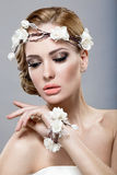 A beautiful woman with flowers on her head Stock Image