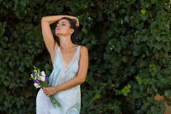 Beautiful woman with a flowers Stock Photography