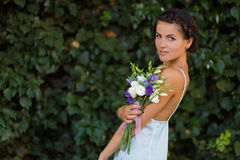 Beautiful woman with a flowers Royalty Free Stock Image