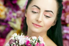 Beautiful Woman With Flowers, 8 march. Beautiful pretty woman with white, pink, yellow flowers, colorful background. Perfect face, brunette, professional make up Stock Photography