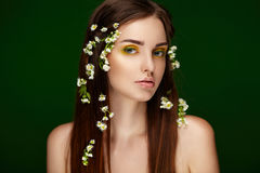 Beautiful woman with flowers. Perfect face skin. Stock Images