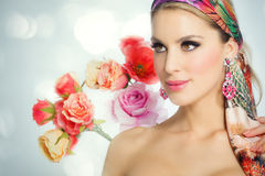 Beautiful Woman In Flowers. Beautiful spring woman with flowers. Glowing colorful summer fashion concept Royalty Free Stock Photos