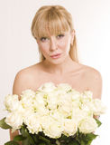 Beautiful woman  with flowers on white background Stock Photography