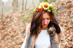 Beautiful woman with flowers wreath in autumn park Royalty Free Stock Photo
