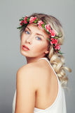 Beautiful Woman with Flowers Wreath. Blonde Curly Hair Stock Photography