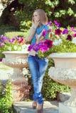 Beautiful woman among the flowers Royalty Free Stock Image