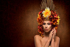 Beautiful woman in flowery headpiece Stock Photo