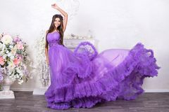 Beautiful woman in a flowing dress Stock Images