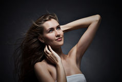Beautiful woman with fluttering hair. Stock Image