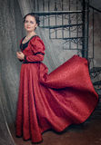 Beautiful woman in fluttering medieval dress Royalty Free Stock Photo