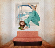 Beautiful woman fly in room Royalty Free Stock Image