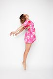 Beautiful woman flying girl in pink dress Royalty Free Stock Photo