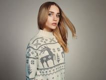 Beautiful Woman with flying hair in winter pullover. Beauty Blond Girl Stock Photography