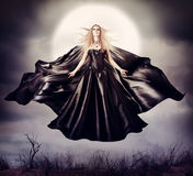 Beautiful woman - flying halloween witch Stock Photo