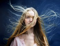 Beautiful woman with flying long hair. Royalty Free Stock Photos