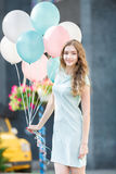 Beautiful woman with flying multicolored balloons Royalty Free Stock Image
