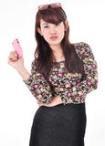 A beautiful woman folded her arms and carry a cell phone Stock Photos