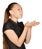 Beautiful woman folded her hands together and. Blowing forward Royalty Free Stock Images
