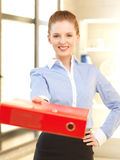 Beautiful woman with folder Royalty Free Stock Photography