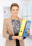 Beautiful woman with folders Royalty Free Stock Image
