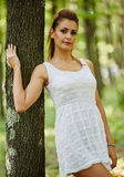 Beautiful woman in the forest Stock Photography