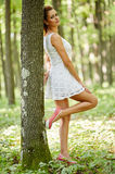 Beautiful woman in the forest Stock Photo