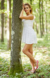 Beautiful woman in the forest Stock Photos