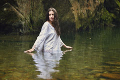 Beautiful woman in forest stream Stock Photos