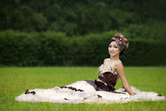 Beautiful woman in formal dress gown at park Royalty Free Stock Image