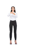 Beautiful woman in formalwear standing and gesturing signed language Stock Images