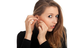 Beautiful woman founds ear-rings Stock Photo