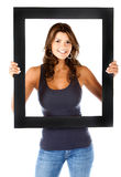 Beautiful woman with a frame Stock Photo