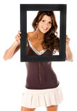 Beautiful woman with a frame Stock Images