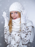 Beautiful woman is freezing with a scarf Royalty Free Stock Image