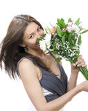 Beautiful woman with fresh bouquet of flowers Stock Images