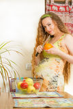 Beautiful  woman with fresh fruit on house kitchen Royalty Free Stock Photography