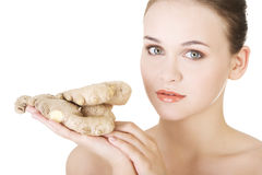 Beautiful woman with fresh ginger Stock Photos
