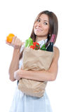 Beautiful woman with fresh organic shopping paper Stock Photo