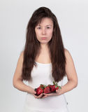 Beautiful woman with the fresh strawberries Royalty Free Stock Images