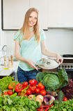 Beautiful woman with fresh vegetables and greens Stock Image