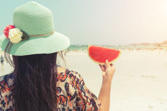 Beautiful woman with fresh watermelon with in hands on tropical beach - vacation in summer royalty free stock photos