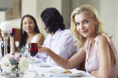 Beautiful Woman With Friends At Diner Party Royalty Free Stock Photography