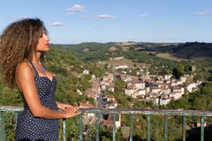 Beautiful woman in front of Caylus Royalty Free Stock Images