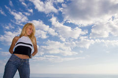 Beautiful woman in front of sky Stock Photo