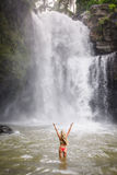 A beautiful woman in front of Tegenungan waterfall in bali Stock Images