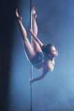 Beautiful woman froze while dancing on pylon Royalty Free Stock Photo