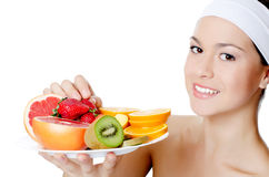The beautiful woman with fruit Royalty Free Stock Photography