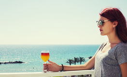 Beautiful woman with fruit juice in glass in hand Royalty Free Stock Photography